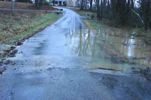 picture of water over country road