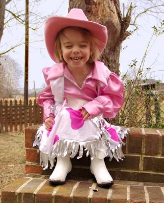 Cowgirl Ellie on brick steps.