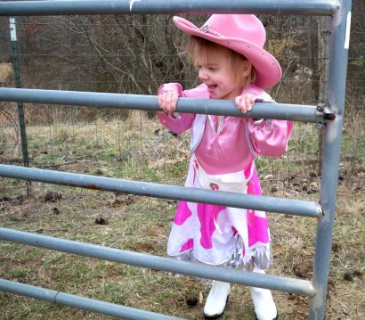 Cowgirl Ellie standing at the gate.