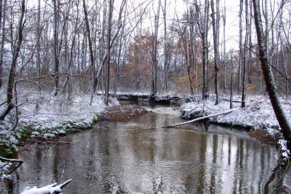 Creek with snowy banks.