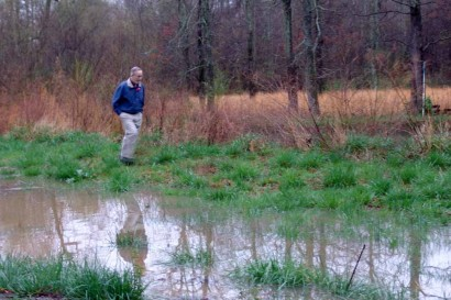 The Farmer looking at the flood waters near the pond.