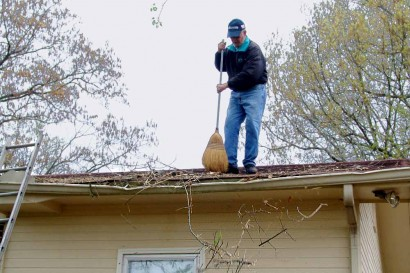 Sweeping off the roof.