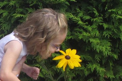 Ellie sniffing a Black-Eyed Susan flower.
