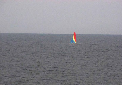 Sailboat on Gulf of Mexico in rainstorm.