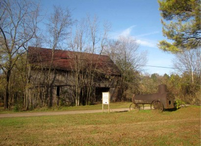 Old Wooden Barn and Antique Steam Engine