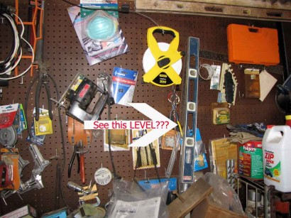 Level hanging on pegboard.