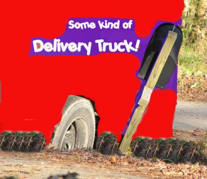 Delivery truck stuck in ditch.