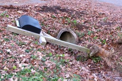 Black rural mailbox on bank.
