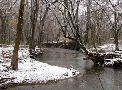 Snow on banks along creek.