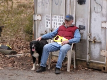 picture of man and farm collie dog