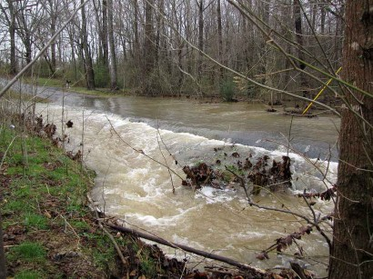picture of creek waters over road