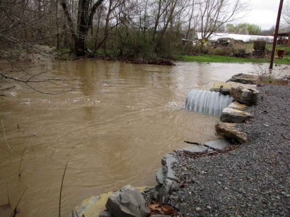 picture of flooded creek and culverts