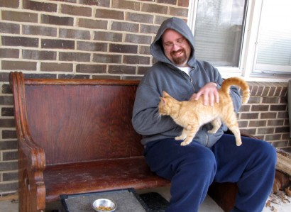picture of cat on man's lap