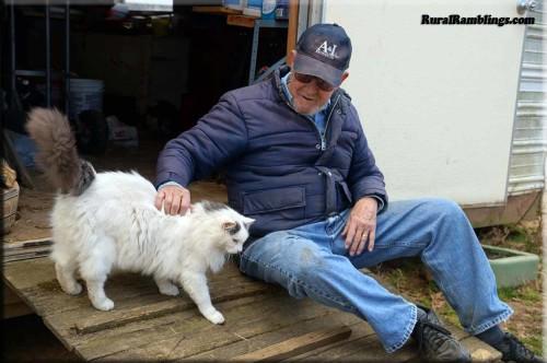 Farmer petting cat