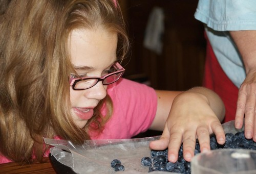 pic of girl and blueberries